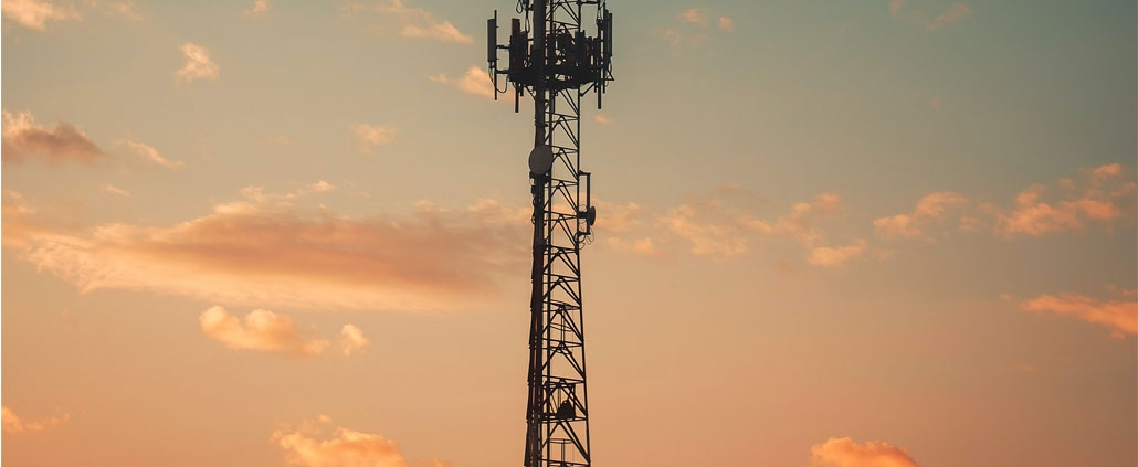 Telephone tower in the sky at dusk